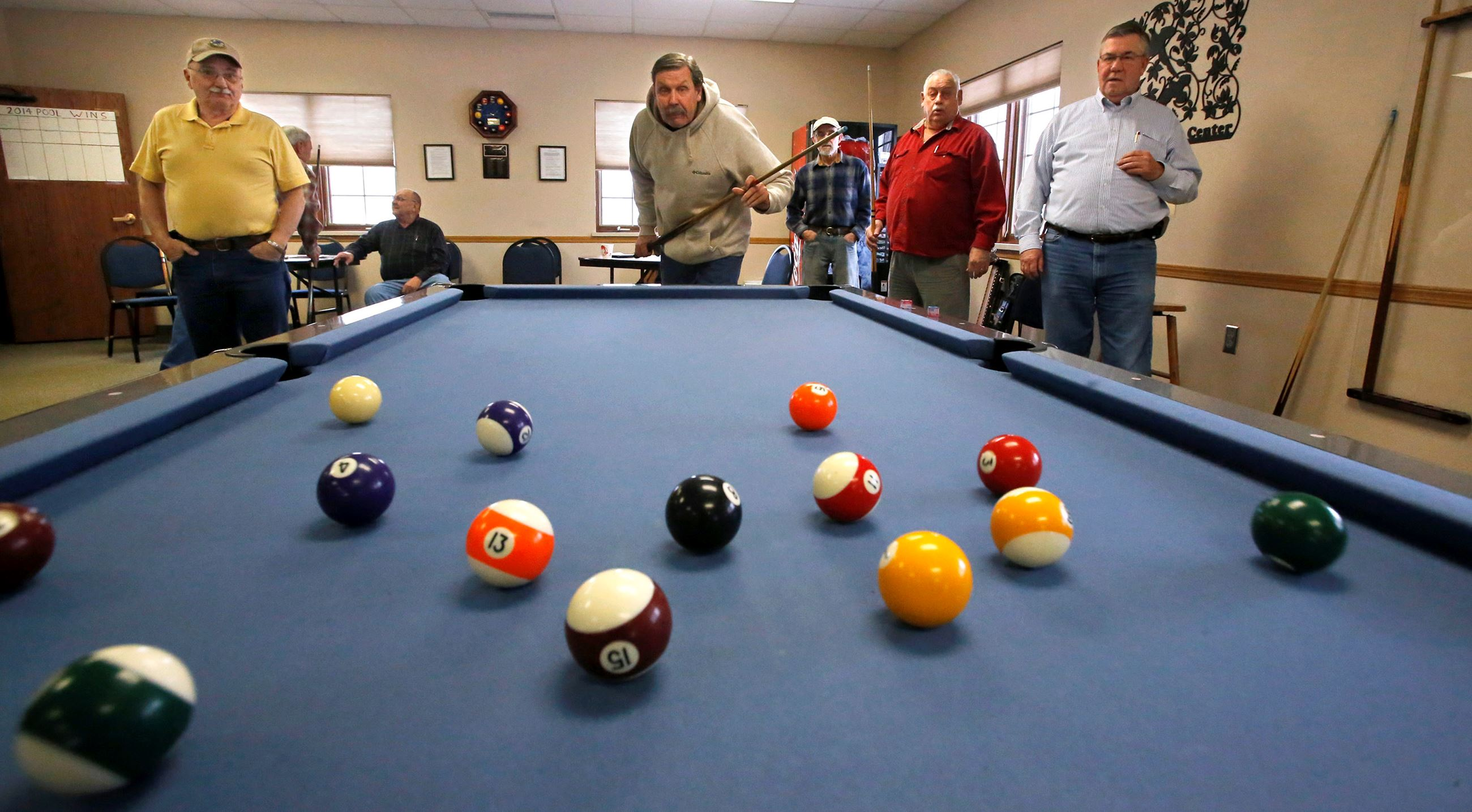 Senior Center Members playing a of pool