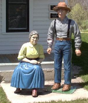 Aunt Em and Uncle Henry greet you at Dorothy's House Gift Shop